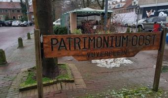 Kleine kerstmarkt met dameskoor op Amsterdamseweg