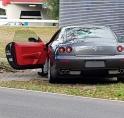 Ferrari met pech strandt in berm Beneluxbaan